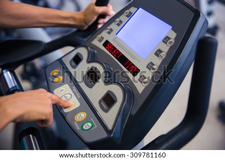 Closeup portrait of interface of fitness machine in gym - stock photo