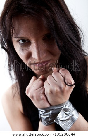 closeup portrait of kidnapped woman, hostage - stock photo