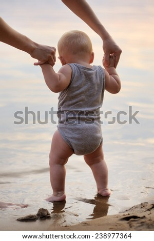 Closeup portrait of little baby by the water  - stock photo