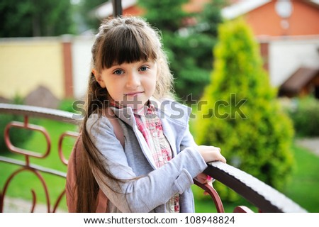 Closeup portrait of little girl in contemporary school outfit - stock photo
