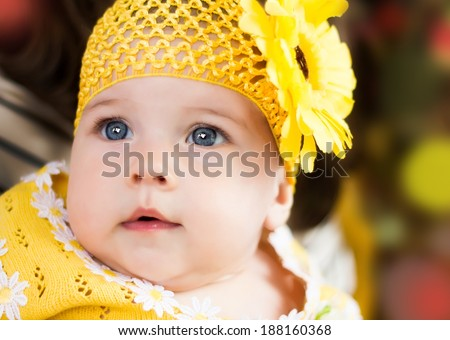 Closeup portrait of little girl in yellow  - stock photo