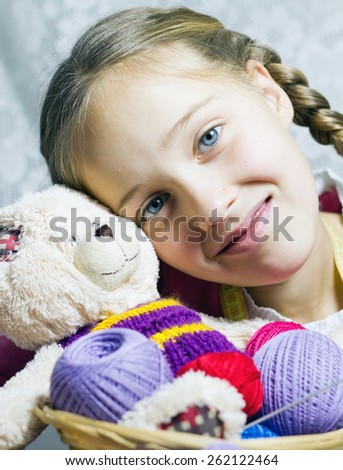 Closeup portrait of little girl with knitting basket - stock photo