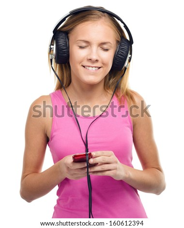 Closeup portrait of lovely teen girl closing her eyes and enjoying music using headphones, isolated over white - stock photo