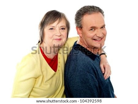 Closeup portrait of loving elderly couple. Wife hugging husband from behind