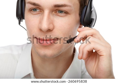 Closeup portrait of male customer service representative or call center worker or operator or support staff speaking with head set, isolated on white background - stock photo