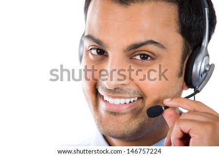 Closeup portrait of male customer service representative or call centre worker or operator or support staff speaking with head set, isolated on white background with copy space