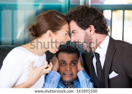 Closeup portrait of man lawyer or counselor caught in between fighting yelling screaming couple on black couch office, trying to close ears because they are so loud, isolated on city urban background. - stock photo