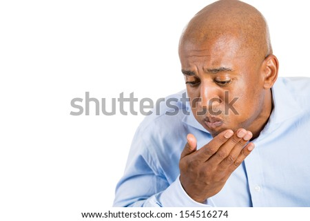 Closeup portrait of man putting covering mouth about to throw up and vomit, isolated on white background with copy space - stock photo