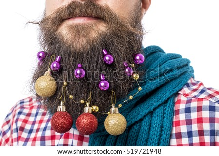 Closeup portrait of man with decoration balls in his beard over white background