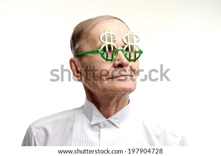 Closeup portrait of man with dollar sign glasses looking aside.Business concept. - stock photo