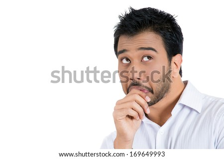 Closeup portrait of man with finger in mouth, sucking thumb, biting fingernail in stress, deep thought, isolated on white background. Negative emotion, facial expression, feelings