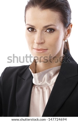 Closeup portrait of mid-adult businesswoman looking at camera smiling confidently. - stock photo