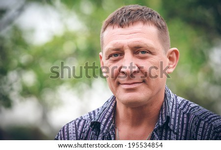 Closeup portrait of middle aged man - stock photo