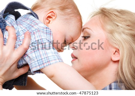 Closeup portrait of mother holding baby son