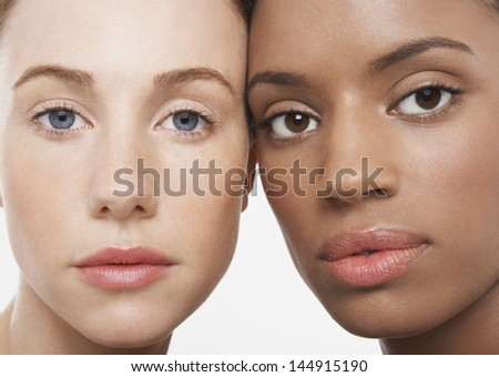 Closeup portrait of multiethnic young women isolated on white background - stock photo