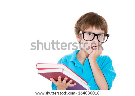 Closeup portrait of nervous boy in big black glasses carrying books looking sideways while biting fingernails, anxious worried, isolated on white background with copy space to left. Negative emotion - stock photo
