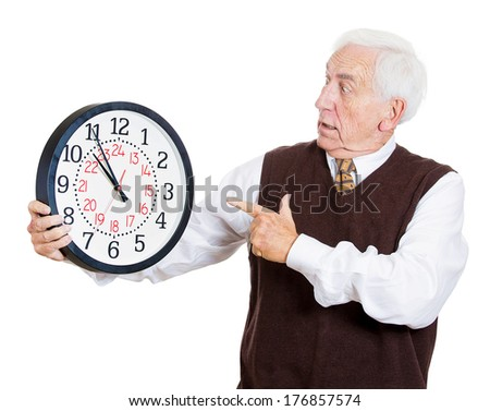 Closeup portrait of old business man, funny looking elderly guy, holding clock, stressed running out, pressured by lack of time, aging, late for meeting isolated on white background. Negative emotions - stock photo
