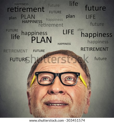 Closeup portrait of old man with glasses looking up contemplating about life isolated on gray wall background with copy space  - stock photo