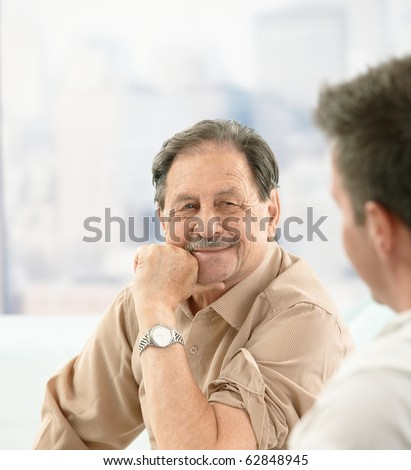 Closeup portrait of older patient smiling at doctor on consultation.? - stock photo