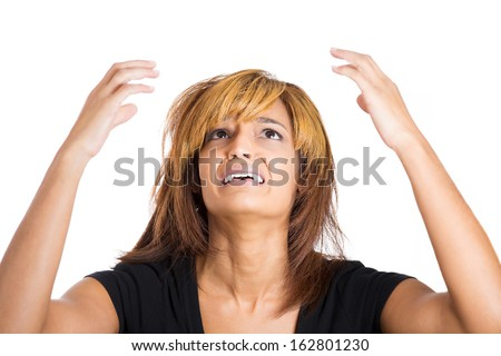 Closeup portrait of overwhelmed, depressed, unhappy,upset young beautiful woman with arms raised in air looking upwards, isolated on white background. Negative human emotion facial expressions - stock photo