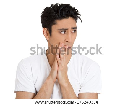 Closeup portrait of paranoid nervous young man looking to side in fear and anxiety hallucinating, isolated white background. Negative emotion facial expression feeling, attitude, reaction, situation - stock photo