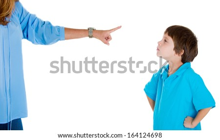 Closeup portrait of parent pointing at child in blue shirt scolding go to room grounded for misbehaving while kid is looking disobedient hands on hips. Isolated on white background.Negative emotion - stock photo