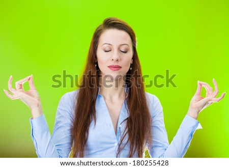 Closeup portrait of peaceful young woman relaxing, meditating, in zen mode, isolated on green background. Positive human emotions, facial expressions, attitude, perception of life, situation, symbols - stock photo