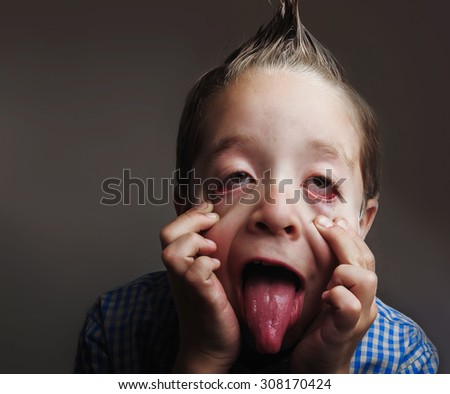 Closeup portrait of playful little boy making funny faces