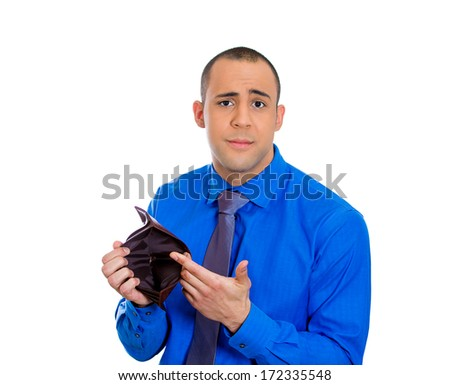 Closeup portrait of poor broke stressed upset sad unhappy young adult man standing holding empty wallet, isolated against white background. Financial difficulties bad economy concept. Negative emotion - stock photo