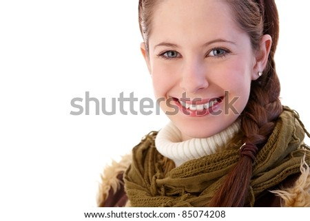 Closeup portrait of pretty girl smiling at camera, wearing scarf.? - stock photo