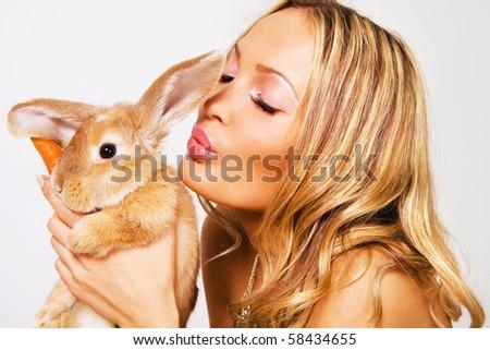 Closeup portrait of pretty girl with a rabbit - stock photo
