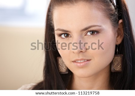 Closeup portrait of pretty young girl looking at camera. - stock photo