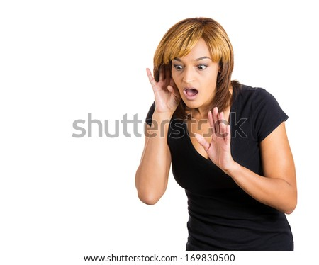 Closeup portrait of pretty young nosy woman trying to secretly listen in on a conversation, hand to ear surprised shocked at juicy gossip she hears, privacy violation, isolated on white background - stock photo