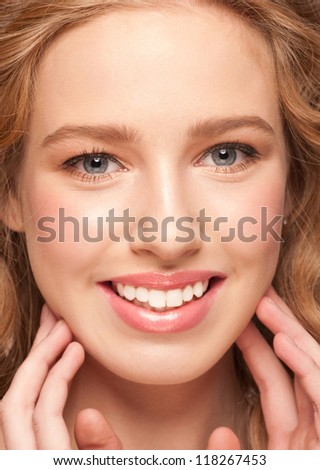 Closeup portrait of pretty young woman with beautiful healthy skin and natural makeup. Isolated on white background