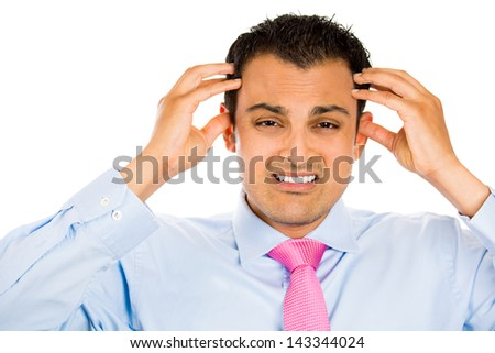Closeup portrait of really stressed out businessman with headache, wearing blue shirt and pink tie, isolated on white background - stock photo