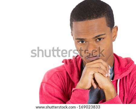 Closeup portrait of really stressed out, sad young guy, deep in thought, low in energy, resting chin on hands, isolated on white background space to left. Human emotions, feelings, attitude, reaction