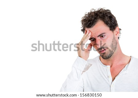 Closeup portrait of really stressed out young guy with headache, deep in thought, low in energy, isolated on a white background with copy space. Human emotions  - stock photo