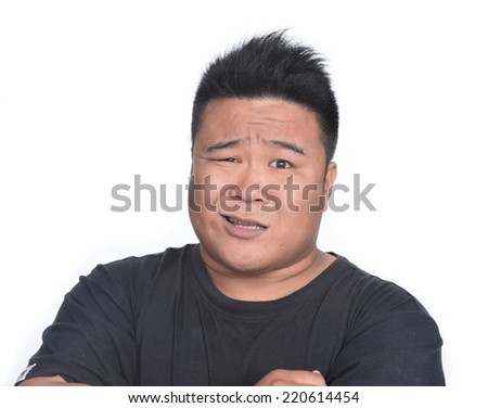 Closeup portrait of really stressed unhappy young handsome man with really bad neck pain, - stock photo