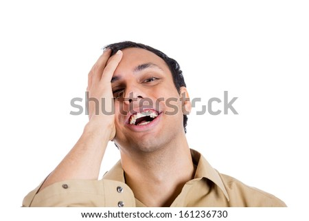 Closeup portrait of relieved young man in brown shirt, smiling with hand on face, isolated on white background. Positive human emotion facial expressions - stock photo