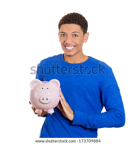 Closeup portrait of rich, super excited young successful, happy man, student, worker, holding his friend, piggy bank, isolated on white background. Financial decisions, money savings, college fund - stock photo