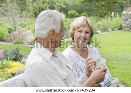 Closeup portrait of romantic old couple drinking champaign