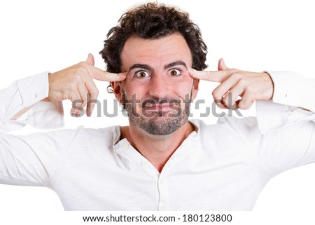 Closeup portrait of rude difficult funny looking young man gesturing with fingers against his temple, are you crazy? Isolated on white background. Negative human emotions, facial expressions, feelings - stock photo