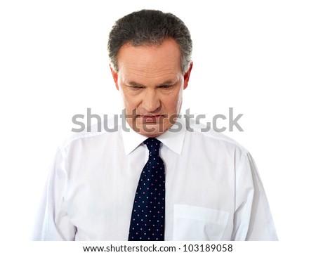 Closeup portrait of sad businessman looking down - stock photo