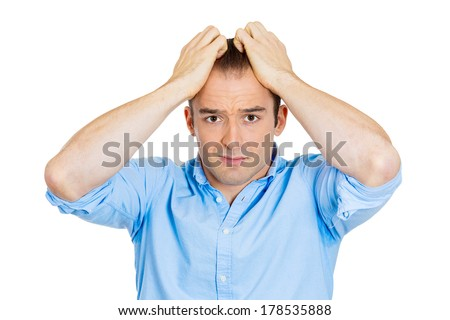 Closeup portrait of sad, confused, unhappy, frustrated, stressed young man, pulling his hair out, expecting bad news, isolated on white background. Negative human emotions, facial expression, reaction - stock photo