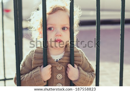Closeup portrait of sad little girl outdoors