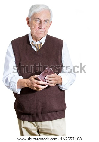Closeup portrait of sad, unhappy, worried,  speechless old man, grandfather holding empty wallet, isolated on white background. Bankruptcy, financial difficulties concept. Human emotions, expressions - stock photo