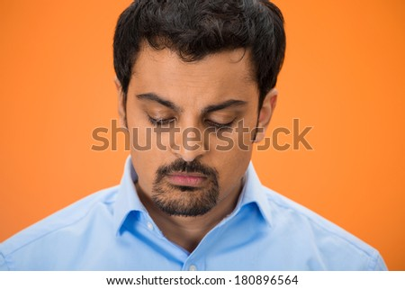Closeup portrait of sad, upset, depressed young business man, student, employee, worker, looking down, totally defeated, isolated orange background. Negative human emotions, face expressions, reaction - stock photo