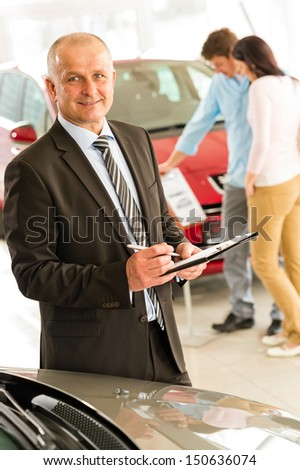Closeup portrait of salesman working in car dealership