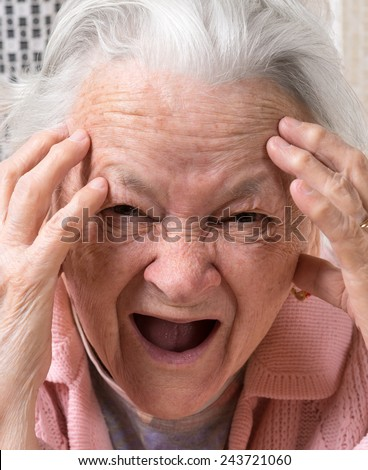 Closeup portrait of scared shouting old woman at home. Negative emotions - stock photo