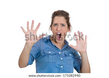 Closeup portrait of scared woman raising hands up in defense, scared about to be attacked or avoiding an unpleasant situation, isolated on white background. Negative emotion facial expression feelings
